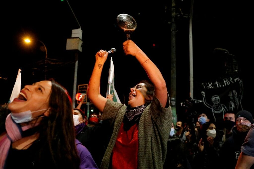 A woman bangs a pot as she reacts to the referendum on a new Chilean constitution in Valparaiso, Chile, October 25, 2020. REUTERS/Rodrigo Garrido