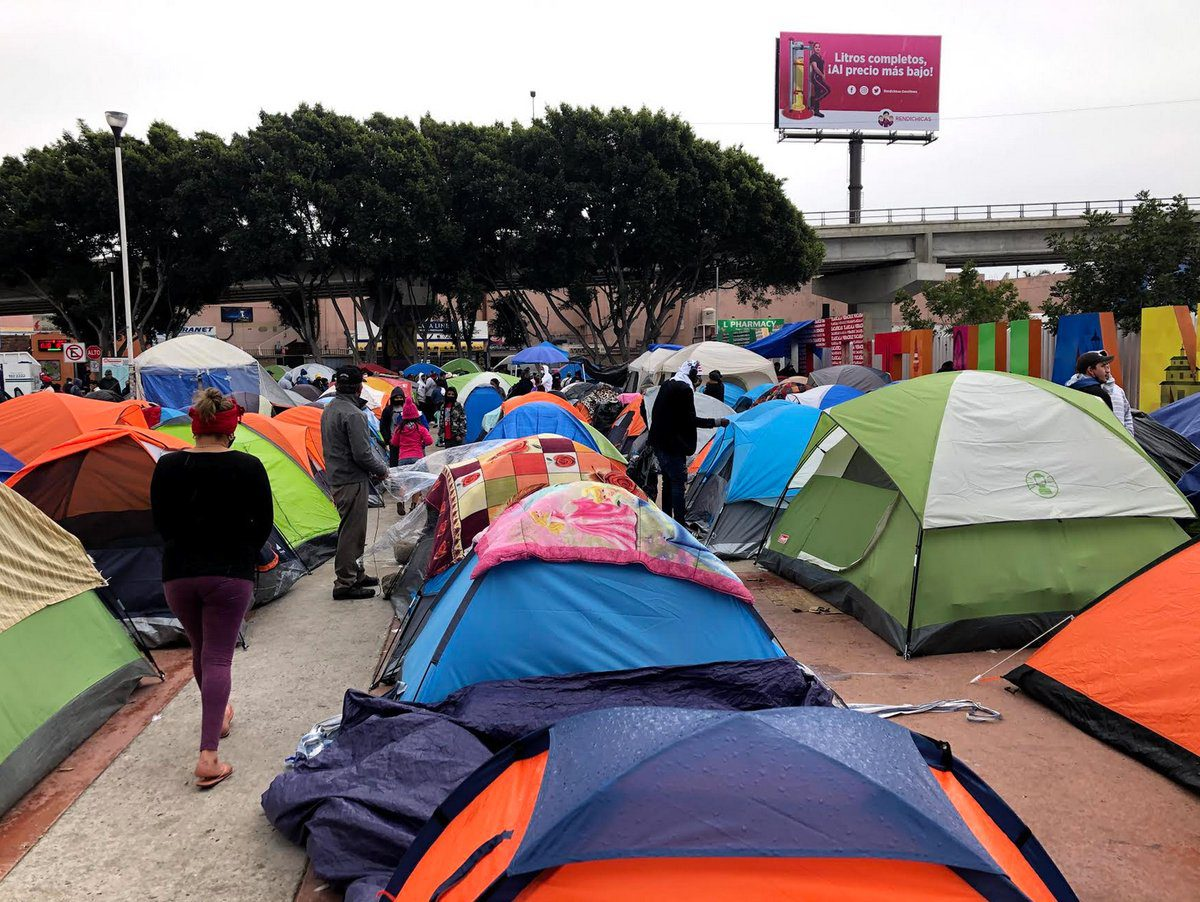 group of colorful camping tents at the border